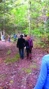 Players hike through the woods to the site where game-play will begin.  (Photo: Liz Rywelski)