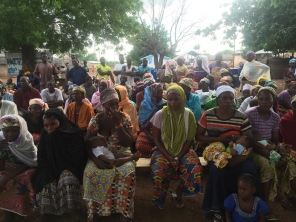 The community of Kukuo gathers to hear the results of the health screening.